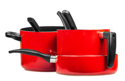 Red cooking pans and pots Stock Images