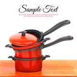Red cookware set. On white background royalty free stock image