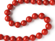 Red coral beads. Glossy red coral beads on white background stock photos
