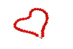 Red coral beads in the shape of a heart royalty free stock image