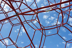 Red cords against the blue sky. The red web Royalty Free Stock Images