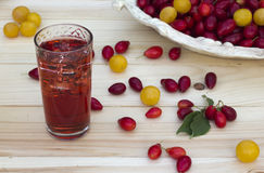 Red corne, cherry-plum  and juice with ice Royalty Free Stock Photography