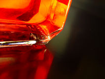 Red Corner. Glas Bottle with a red liquid Royalty Free Stock Photography