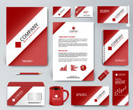 Red corporate identity set with white ribbon on red backdrop Royalty Free Stock Photos