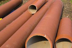 Red corrugated ceramic pipes Royalty Free Stock Image