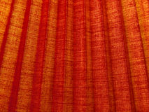 Red corrugated fabric texture.Background. Royalty Free Stock Photography
