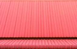 Red corrugated metal sheets roofs stock photos