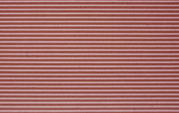 Red corrugated paper background. Royalty Free Stock Image