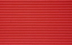 Red corrugated paper background. Royalty Free Stock Photos