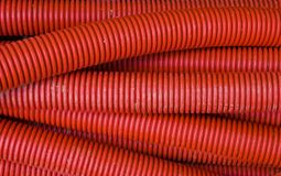 Red corrugated pipe Royalty Free Stock Images