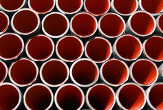 Red corrugated pipes for laying electric cables Royalty Free Stock Photography