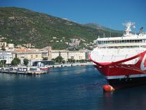 Red Corsican ferry boat with view on Livorno Italy harbor Royalty Free Stock Photos
