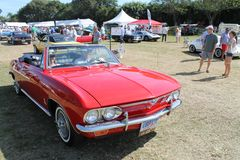 Red Corvair convertible driving on lawm Stock Photography