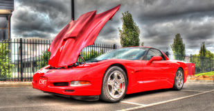 Red Corvette. A red Corvette with the hood raised Stock Images