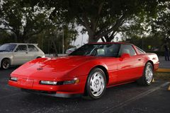 Red Corvette lit with studio strobes in a parking lot. MIAMI, FL, USA - JANUARY 27, 2018: Image of a mint condition red corvette lit with studio lights Stock Images