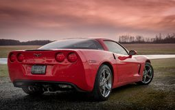 Red corvette sunset royalty free stock photo