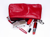 Red cosmetic bag full of items Stock Photo
