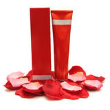 Red cosmetic bottle, box and rose petals Royalty Free Stock Photo