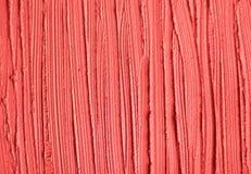 Red cosmetic clay/facial mask/cream/body wrap texture close up, selective focus. Abstract background with brush strokes. Red cosmetic clay/facial mask/cream/body stock photos