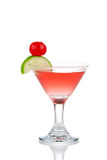 Red Cosmopolitan martini cocktail with vodka. Rum,  liqueur, lemon juice, pineapple, maraschino cherry in small martinis cocktails glass isolated on a white Stock Images
