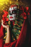 Red costume for halloween. A close-up portrait of Calavera Catrina. Sugar skull makeup. Dia de los muertos. Day of The Dead. Halloween royalty free stock photo