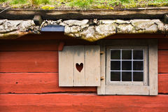 Red cottage. Window of a red wooden cottage Royalty Free Stock Photography