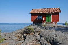Red cottage on a cliff Stock Photo