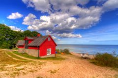 Red cottage house at the beach of  Baltic sea. In Sweden Stock Photo