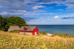 Red cottage house at the beach of  Baltic sea. In Sweden Royalty Free Stock Photography