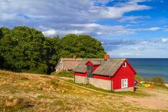 Red cottage house at the beach of  Baltic sea. In Sweden Royalty Free Stock Image