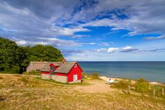 Red cottage house at the beach of  Baltic sea. In Sweden Royalty Free Stock Photo