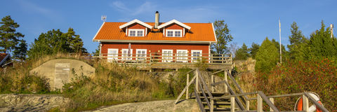 Red cottage on the island Harstena in Sweden Stock Photos