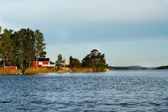 Red cottage. At a lake Royalty Free Stock Photos