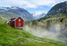 Red cottage. Mist Stock Photo