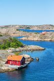 Red cottage by the sea royalty free stock image