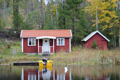 Red cottage. A small red cottage by the lake, Sweden stock images