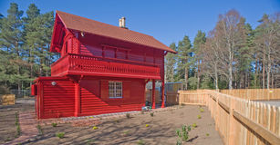 Red cottage Swiss style. A historic red cottage Swiss style newly refurbished Royalty Free Stock Photo
