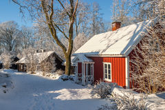 Red cottage in a winter landscape Stock Image