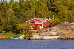 Red cottages on a the coast of Sweden Stock Photo