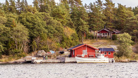 Red cottages and fishing boat in south Sweden Royalty Free Stock Photo