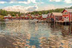 Red cottages on the harbor. A Beautiful summer day at the coast Royalty Free Stock Images