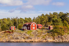 Red cottages on rocky island in Sweden Stock Photo