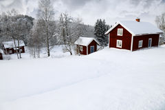 Red cottages in winter Stock Photo