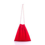 Red cotton bag for coin. Studio shot isolated on white Royalty Free Stock Images