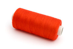 Red Cotton reel over white Stock Photo