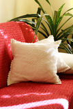 Red couch. With two white pillows Royalty Free Stock Photos
