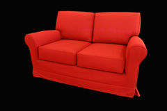 Red couch. Isolated on black Royalty Free Stock Photography