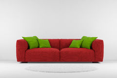 Red couch with carpet Stock Photos