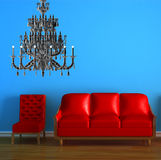 Red couch and chair with chandelier Stock Images