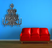 Red couch with chandelier Royalty Free Stock Photos